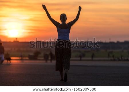 evening city sundown with woman #1502809580