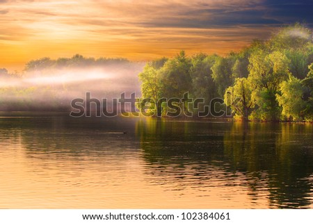 Evening Dnieper river covered with haze