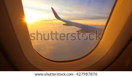 Evening flight on twilight sky, amazing view from the window plane.