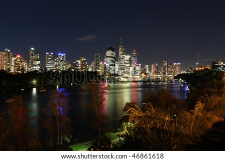 Evening image of Brisbane City, the Brisbane River and plants and parkland at Kangaroo Point in Queensland, Australia.