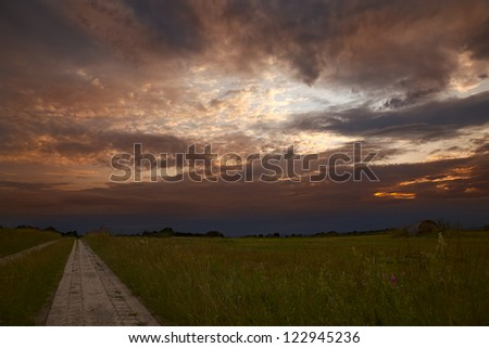 Evening landscape with clouds and a fields road, summer, by Honzrath, Saarland/Germany,