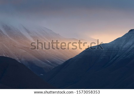 Photo of  Evening light in a valley, fjord, Isfjorden, Spitsbergen, Svalbard Islands, Svalbard and Jan Mayen, Norway
