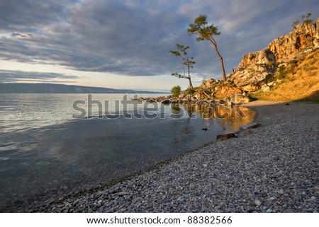 Evening light landscape at the Baikal lake coast. Siberia.