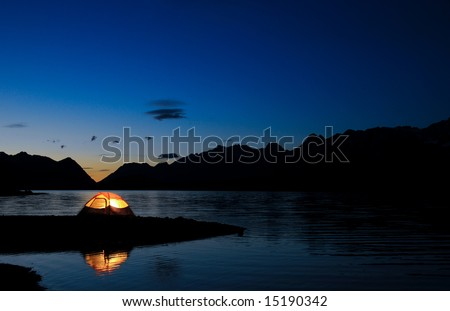 Evening lit tent in camping by nature