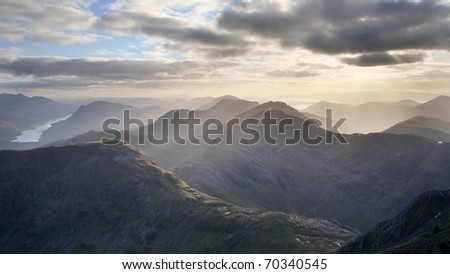 Evening over the scottish highlands seen from the summit of Bidean Nam Bian, near Glencoe. - stock photo