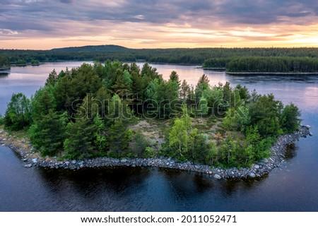 Evening panorama on Karelian lake Kovdozero. Settlement Zelenoborsky, Kandalaksha, Murmansk region, Kola Peninsula. Polar day. Karelian landscape Zdjęcia stock ©