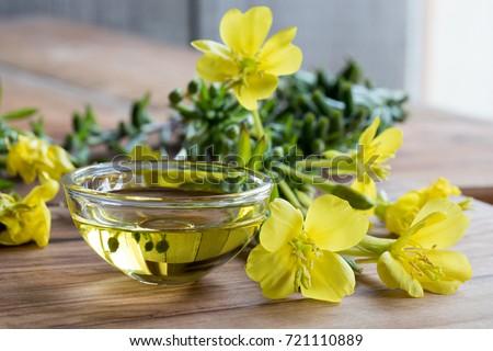 evening primrose oil in a glass ...