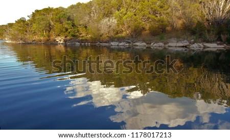 Evening reflection of sky on possum kingdom lake