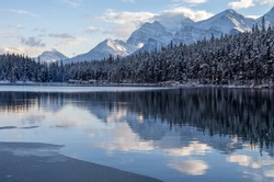 Evening Reflections of Snow Capped Mountains on Herbert Lake, Icefields Parkway