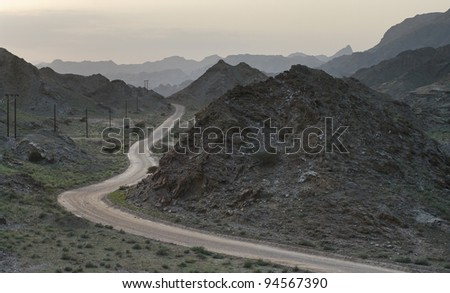 evening road winding in mountains Oman