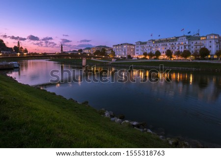 Evening Salzburg in the evening lights on the lake is the most beautiful city in Austria. #1555318763