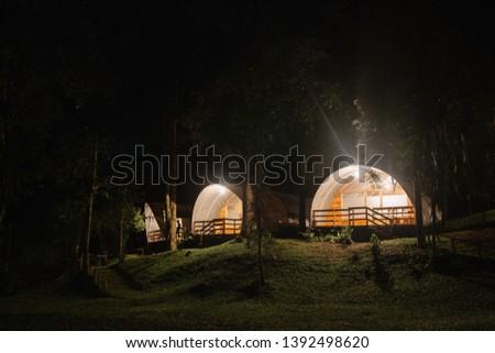 Evening scene of Glamorous Camping Tent at Situgunung Suspension Bridge located in Gede-Pangrango Mountains National Park, Sukabumi, Indonesia