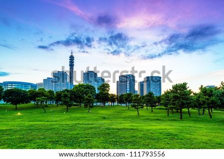 Evening scene of modern city with park in Yokohama City, Kanagawa, Japan