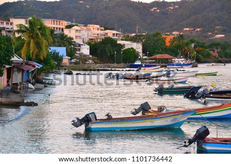 Evening scene of Sainte-Luce harbor in Caribbean island of Martinique, just before sunset. Sainte-Luce is a town and commune in the French overseas department of Martinique.