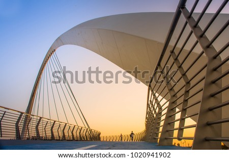 evening shot of Dubai Water Canal Bridge New Attraction of Dubai City, place to visit in UAE, tourist place in dubai, travel destination, modern architecture, beautiful sunset  #1020941902