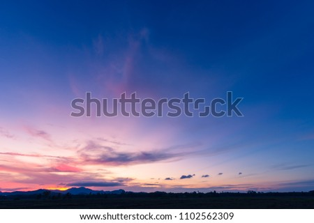 Photo of  Evening sky,Amazing Colorful sky and Dramatic Sunset,Majestic Sunlight Cloud fluffy,Idyllic Nature Peaceful Background,Beauty Dark Blue Hour on Dusk,Purple Nightfall Silhouette mountain on twilight