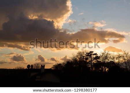 evening sky and trees silhouette #1298380177