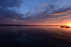 Evening sky at sunset over the lake water surface