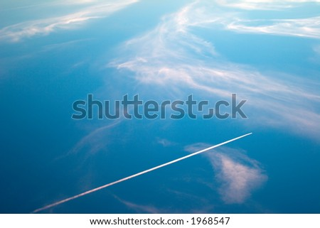 Evening sky with the plane leaving white line