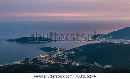 Evening skyline of coastline with Budva and Becici tourist resorts #703306294