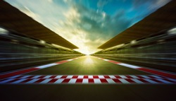 Evening speedy motion blur international race track with starting and finishing line .