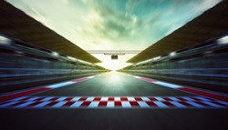 Evening speedy motion blur international race track with starting finishing line and light .