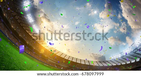 Evening stadium arena soccer field championship win. Confetti and tinsel . Yellow toning. Wide angle