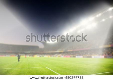evening stadium arena soccer field with flood light - defocused background #680299738