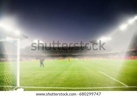 evening stadium arena soccer field with flood light - defocused background #680299747