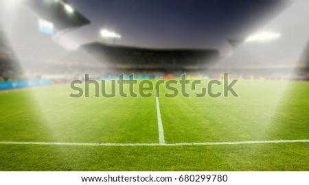 evening stadium arena soccer field with flood light - defocused background #680299780