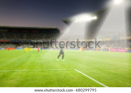 evening stadium arena soccer field with flood light - defocused background #680299795