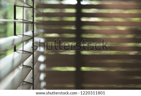 evening sun light outside with wooden window blinds, sunshine and shadow on window blind, decorative interior home concept #1220311801