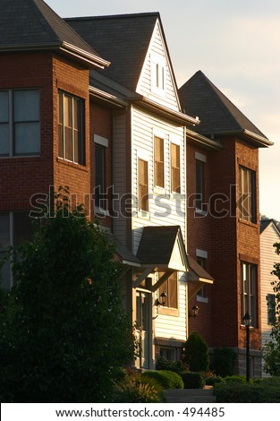 Evening sun on a townhome.