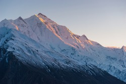 Evening sunset light over Rakaposhi mountain peak view from Hunza valley, Karakoram mountains range in Gilgit Baltistan, Pakistan, Asia