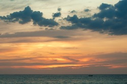 Evening sunset on the sea. Sky with clouds and clouds. Nostalgia. Calm. Evening beach.