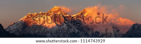 Evening sunset red colored view of Everest and Lhotse with beautiful clouds from Kongde village, Khumbu valley, Solukhumbu, Nepal Himalayas mountains
