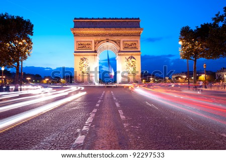 Evening traffic on Champs-Elysees in front of Arc de Triomphe Paris  France