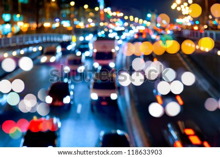 Evening traffic. The city lights. Motion blur. Abstract background.