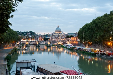 Evening view at the Angelo bridge and St. Peter's Basilica in Rome, Italy