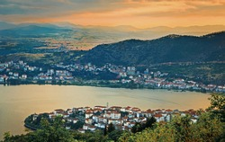 Evening view from above the old Greek city of Kastoria, the lake and the mountains around