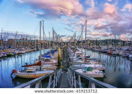 Evening view from the pier to yachts in the cozy port city of Cherbourg-Oktervill (Cherbourg) in the north-west of France. Peninsula of Cotentin, on the coast of the English Channel ( la Manche).