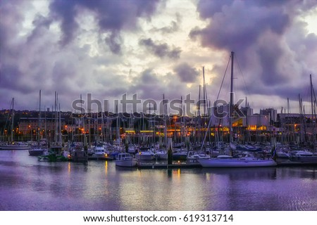 Evening view from the pier to yachts in the cozy port city of Cherbourg-Oktervill (Cherbourg) in the north-west of France. Peninsula of Cotentin, on the coast of the English Channel ( la Manche)