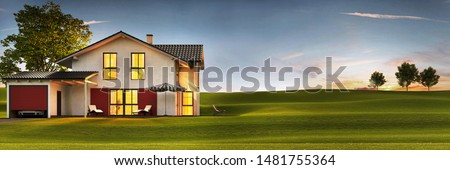 Evening view of a modern house with a lawn and a terrace. 3d rendering