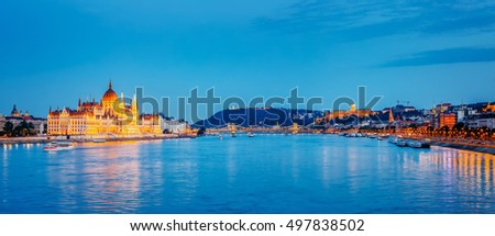 Evening view of Hungarian Parliament and Budavari Palota with Margit bridge. Popular tourist attraction. Dramatic and picturesque scene. Famous location place Budapest, Hungary, Europe. Beauty world. Stock fotó ©