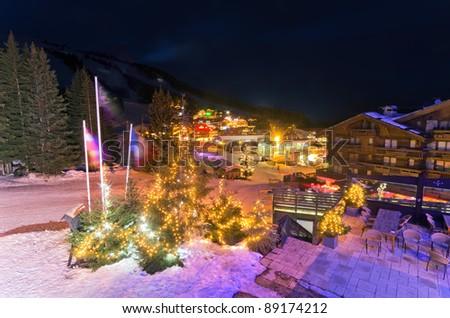 Evening View of ski area & Le Croisette shoppin Area during winter season, Courchevel, France