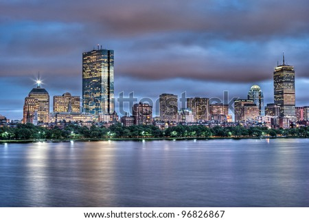 Evening view of the Boston Skyline with brightly illuminated buildings in HDR