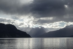 evening view of the north rocky mountain  sea strait on the Norwegian fjord