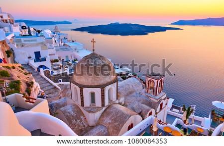 Evening view of Thira town and Aegean sea at sundown, Santorini Island, Greece