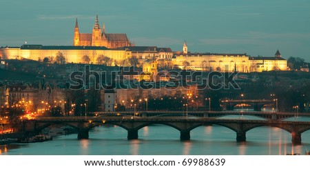 Evening view on Saint Vit Cathedral in Prague Castle and St. Nicholas Church from Vyshegrad point