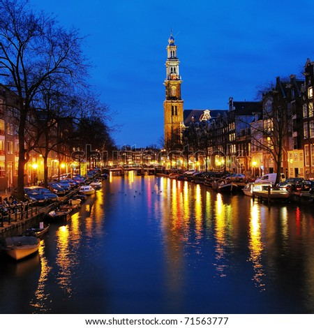 Evening view on the Western church from Prinsengracht channel in Amsterdam, Netherlands